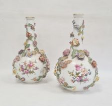Pair of Dresden bottle vases, circa 1900, printed AR Dresden marks, painted with scenes of lovers in