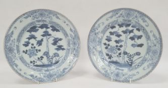 Pair of Chinese export blue and white plates, 18th century, painted with flowering trees and
