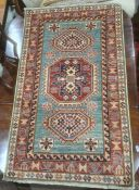 Modern Eastern-style rug, green ground with three central hooked medallions, stepped border, 145cm x