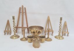 Pair of brass candlesticks, each with open spirally turned column, another pair of candlesticks,