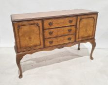 20th century walnut sideboard, the rectangular top with moulded and carved edge