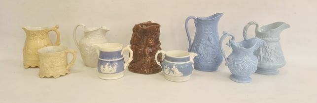 Group of Staffordshire pottery relief moulded wares, mid-19th century, comprising five jugs