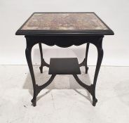 Late Victorian side table, the top decorated with cigar papers, on ebonised base, 66cm wide
