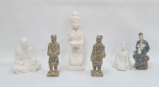 Group of Asian stone, plaster and porcelain figures, 20th century, including an Indonesian figure of
