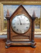 19th century rosewood bracket clock having pointed arched top and pointed square section finials,