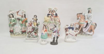 Six Staffordshire pottery figuresand a continental porcelain figure, mid to late 19th century,