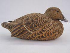 Philip Nelson decoy duckof female eider duck, marked April 93 to base 17 cms h. x 38 cms