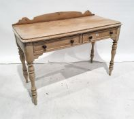 Late 19th/early 20th century pine washstandwith galleried back, rectangular top, rounded front