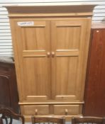 20th century pine wardrobewith moulded cornice above two drawers, on plinth base