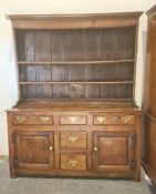 18th century oak dresser, moulded cornice with two shelves, base of five assorted drawers and two