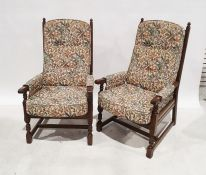 Possibly Ercol three-piece suitecomprising two-seater sofa and two armchairs, in foliate upholstery