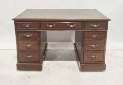 20th century mahogany pedestal deskwith green leather inset top, nine assorted drawers, on plinth