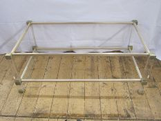 A two tier coffee table by Pierre Vandel, clear perspex with metal mounts, maker's label, 99cm