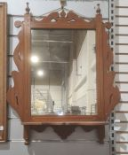 Late 19th/early 20th century rectangular mirrorin mahogany frame, with shelf under