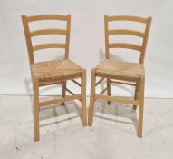 Four 20th century beech framed wicker seated chairsand a linen basket(5)
