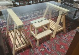 Modern glass topped table on adjustable work bench type bases together with kitchen steps (2)