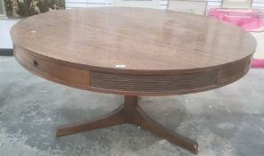 Archie Shine for Heal's circular centre table in rio rosewood, four drawers to frieze on cylindrical
