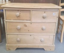 Late 19th century pine chestof two short and two long drawers, the rectangular top with applied