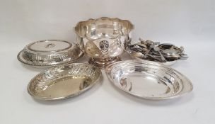 Quantity of silver plate including a large punch bowl with lion mask handles, an oval vegetable dish