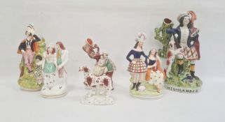 Six Staffordshire pottery figures, mid 19th century, comprising a highlander spill vase, 32cm