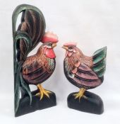 Two modern carved and painted wood cockerels, 59cm and 40cm high (2)