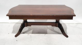20th century mahogany coffee tableon turned end pillar supports united by stretcher, 122cm wide