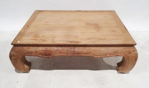 Oriental-style coffee tablein limed-effect finish, the rectangular top on four carved supports,
