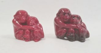 Two Royal Doulton flambe groups of monkeys, printed marks, circa 1920, one with black EM monogram to