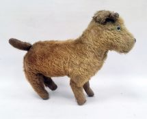 Early 20th century gold plush and straw stuffed toy dog, 32cm long (worn)