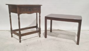 20th century trapezoidalsingle drawer side tableon turned supports, stretchered base and a