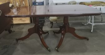Modern mahogany extending dining table, by Frank Hudson,with moulded edge, on twin pedestal