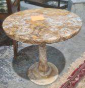 Polished stone circular coffee table on single pedestal and one further (damaged)