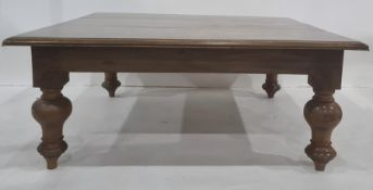 20th century mahogany coffee table, the square top with moulded edge, on turned supports to peg feet
