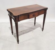 Early 20th century mahogany card table, the serpentine front fluted and supported to peg feet