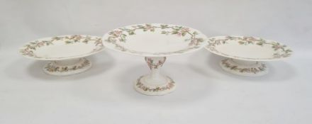 Three Royal Worcester comports, circa 1880, printed puce marks, comprising one tall footed comport