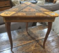 Modern marquetryinlaid triangulartopped musical lift-top occasional table to cabriole legs
