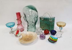 Blue and ochre mottled handbag-shaped glass vase, an aqua glass female bust, a cranberry vase, six