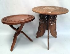 Two Eastern-style carved circular coffee tables(2)