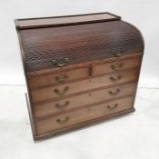 19th century mahogany roll-top desk with fitted interior above two short and three long graduated