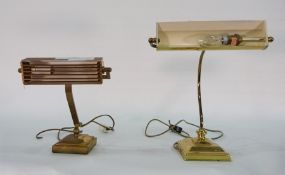 Vintage-style brass desk lampwith articulated arms anda modern brass-coloured metal desk lamp (2)
