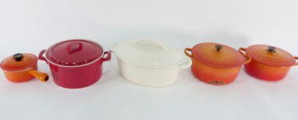 Large Maxwell Williams ceramic casserole, a cream cast iron casserole,two orange Le Creuset