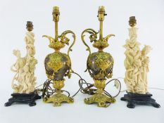 Pair of elaborate faux-ormolu and faux-marble table lamps, a pair of faux-ivory table lamps