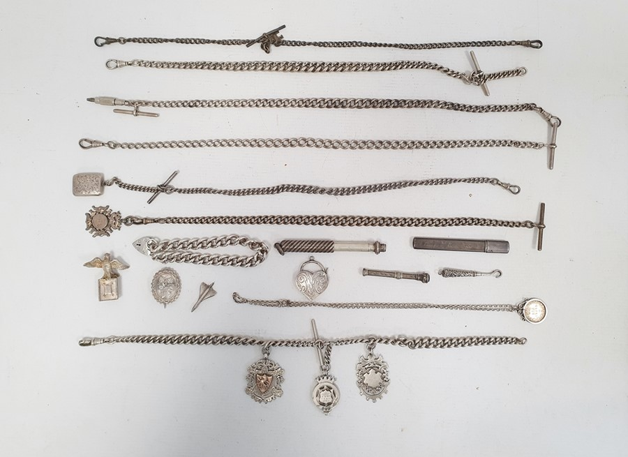 Quantity of silver curb link watch chains, some hung with silver fobs, a silver curb link bracelet