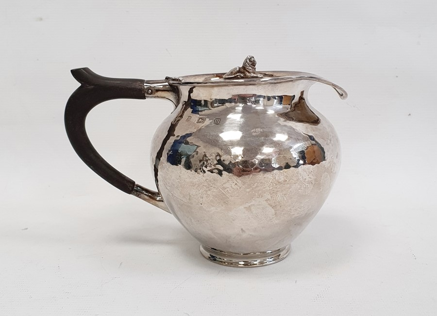 Silver covered jugby A E Jones, London 1911 of circular form with hammered finish, the hinged cover - Image 4 of 12