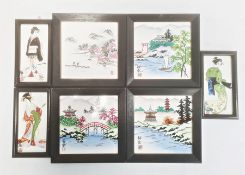 Collection of four Japanese ceramic tiles with lakeside landscape decoration and a set of three