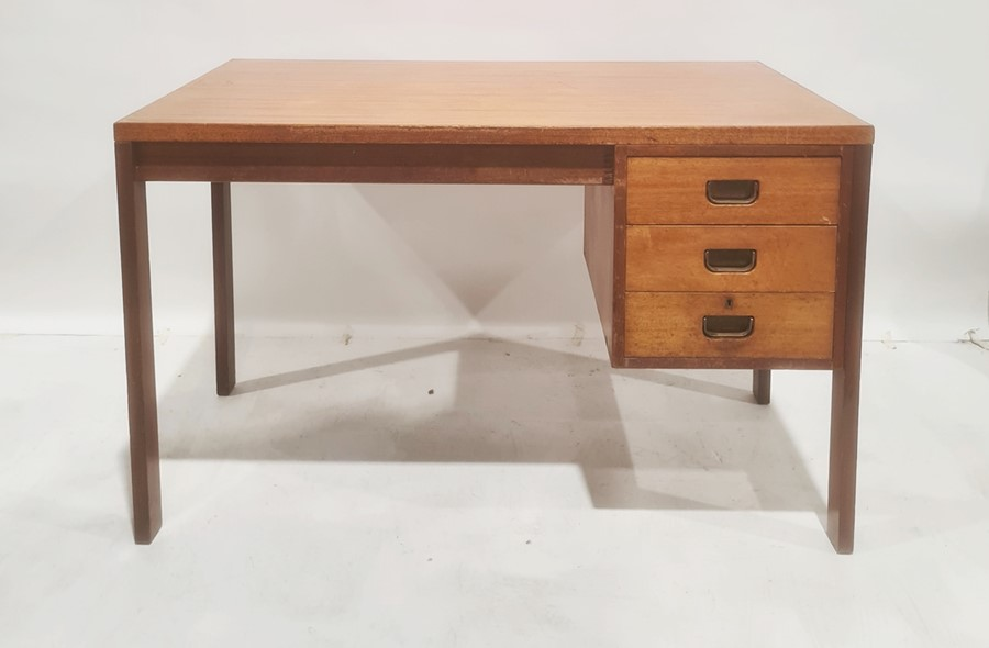 20th century Gordon Russell desk with three drawers, on rectangular section supports bearing label