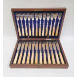 Set of 12 pairs EPNS and yellow-handled fish eatersin mahogany case