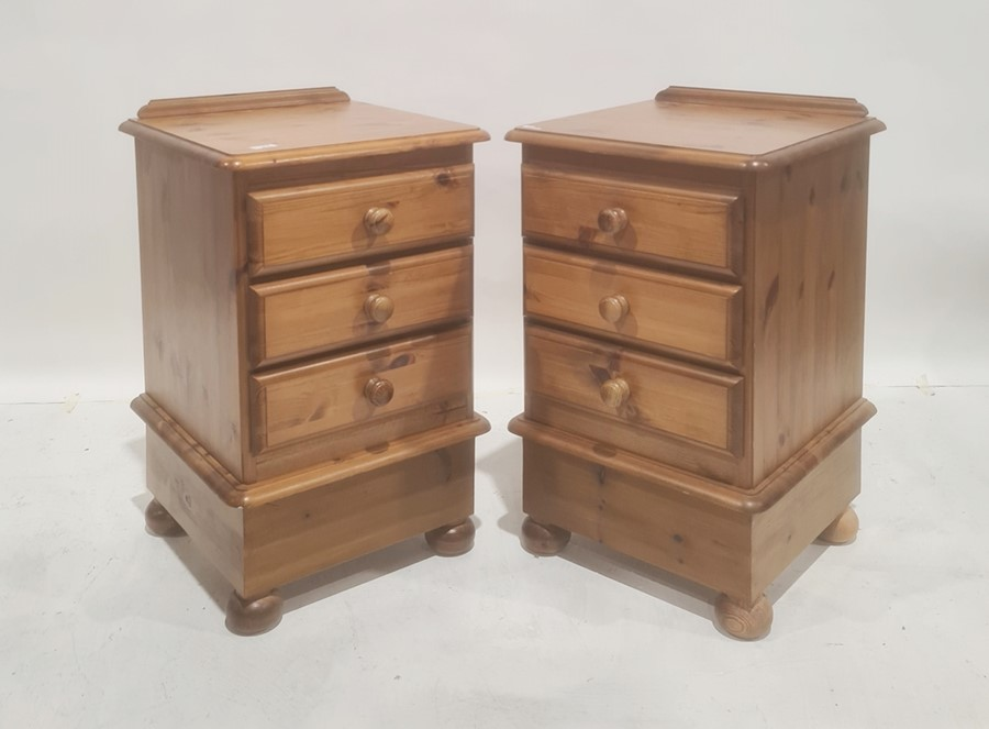 Pair 20th century pine bedside chests on ball feet (2)