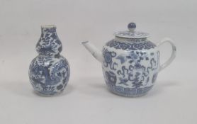 Chinese porcelain teapot, bulbous and decorated in blue with preciousobjects, 11cm high (repaired