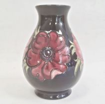 Moorcroft pottery vase, baluster-shaped, the royal blue ground decorated with anemones, 14cm
